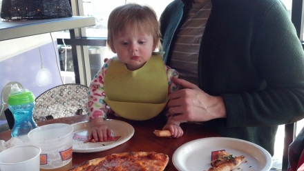 Lilli has discovered the wonders of pizza.